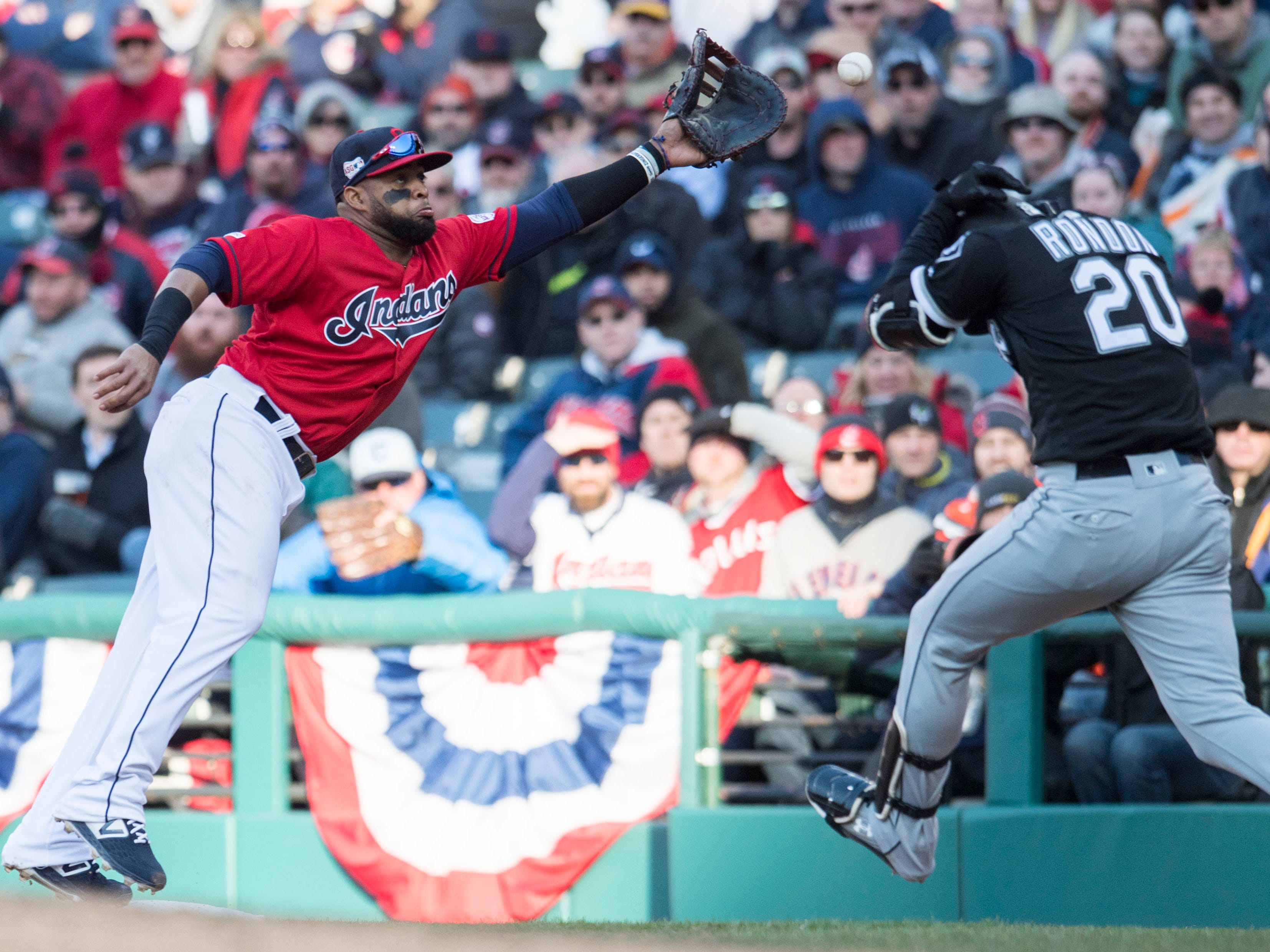 April 1: The Chicago White Sox's  Jose Rondon is safe as Cleveland Indians first baseman Carlos Santana leaps for an errant throw from relief pitcher Adam Cimber during the eighth inning at Progressive Field. The Indians won the game, 5-3.