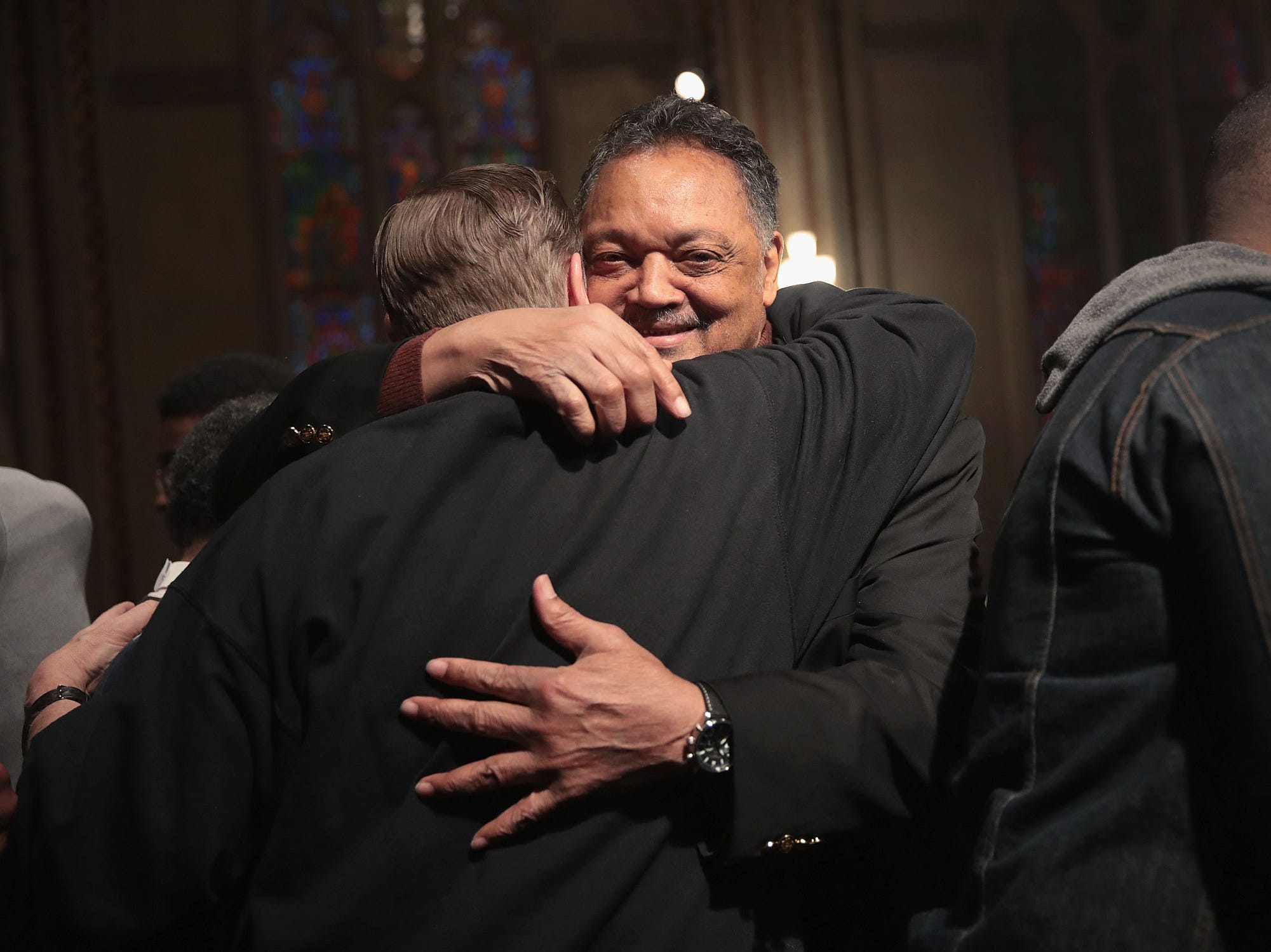 Rev. Jesse Jackson and Father Michel Pfleger embrace after voicing their support for Cook County State's Attorney Kim Foxx before the start of a protest organized by the Fraternal Order of Police calling for the removal of Foxx on April 1, 2019 in Chicago.