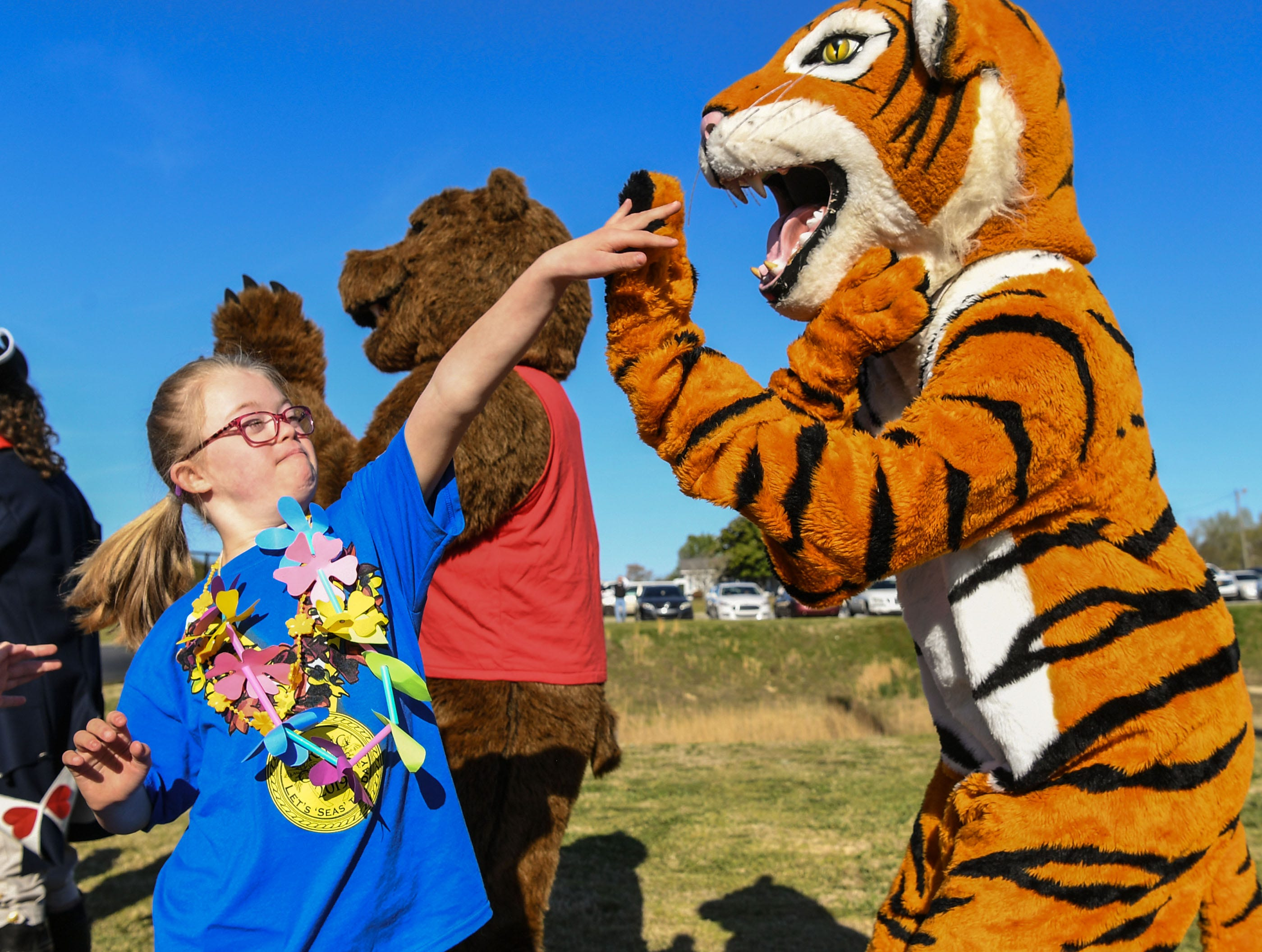 Athlete Gracie Selfridge of West Pelzer Elementary School gives a high-five to the Crescent High School tiger mascot before the Special Olympics South Carolina Area 14 Spring Games at Marlee Gambrell field at Belton-Honea Path High School Wednesday.