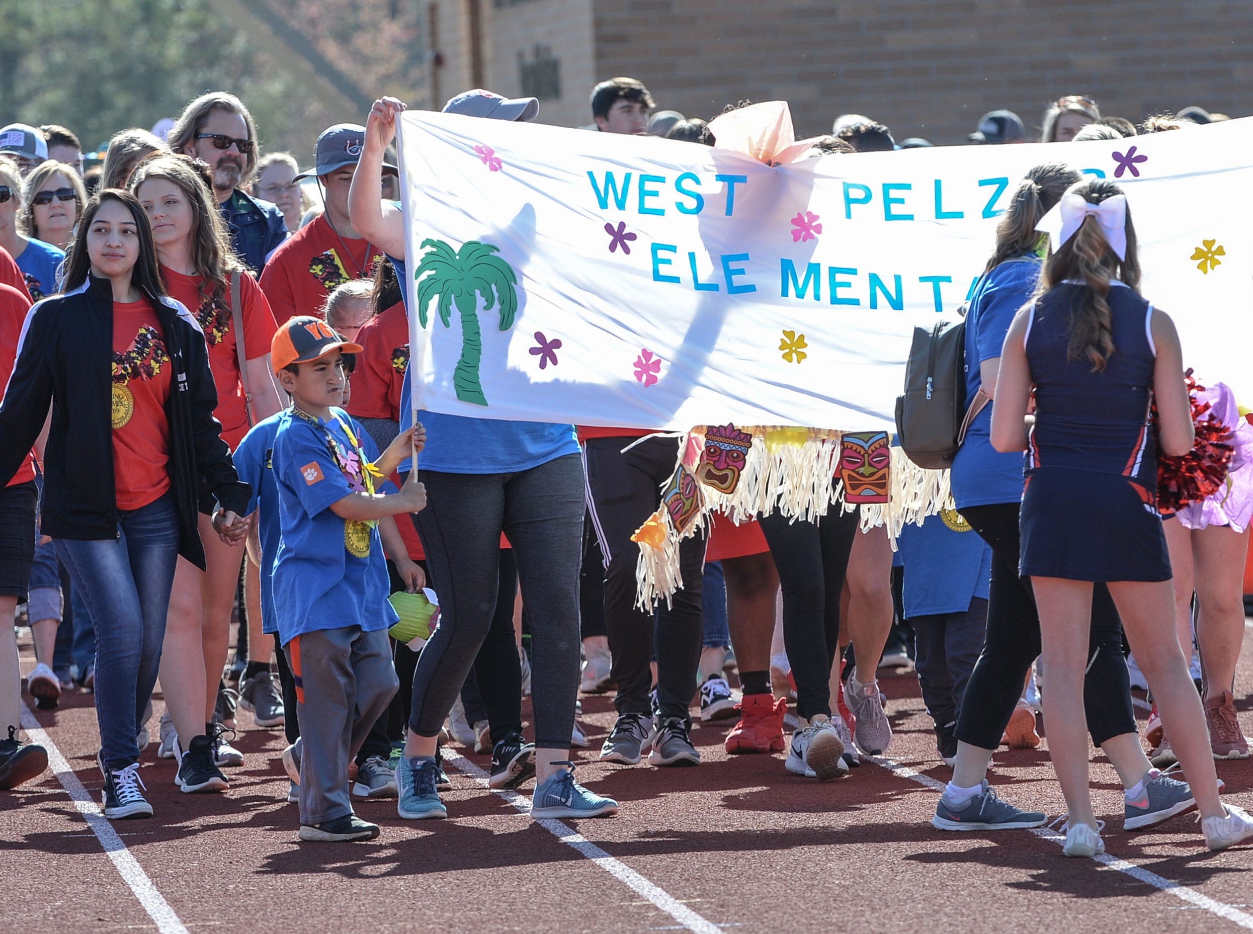 The opening parade with athletes from West Pelzer Elementary during the Special Olympics South Carolina Area 14 Spring Games at Marlee Gambrell field at Belton-Honea Path High School Wednesday.