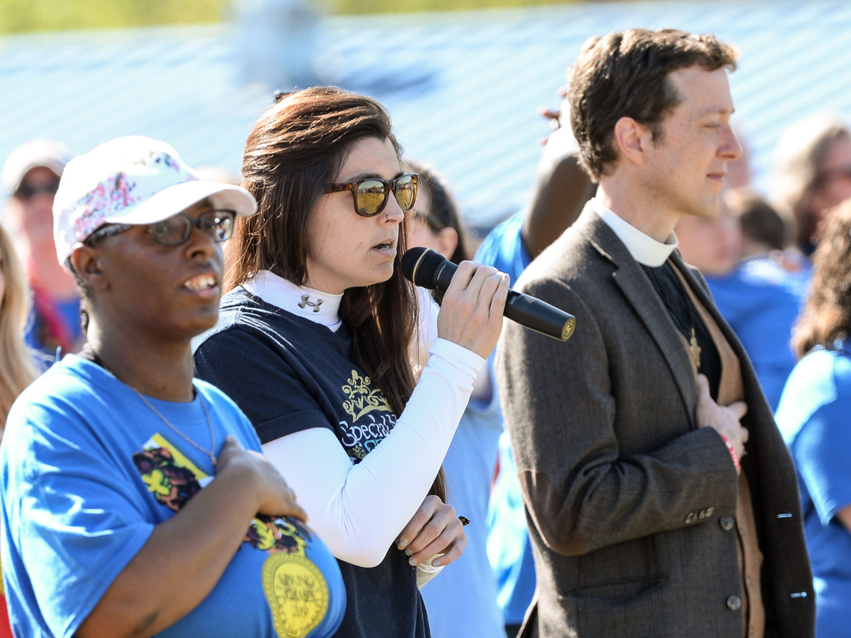 Lauren Ross, middle, of Freedom Fitness, sings the National Anthem during the Special Olympics South Carolina Area 14 Spring Games at Marlee Gambrell field at Belton-Honea Path High School Wednesday.