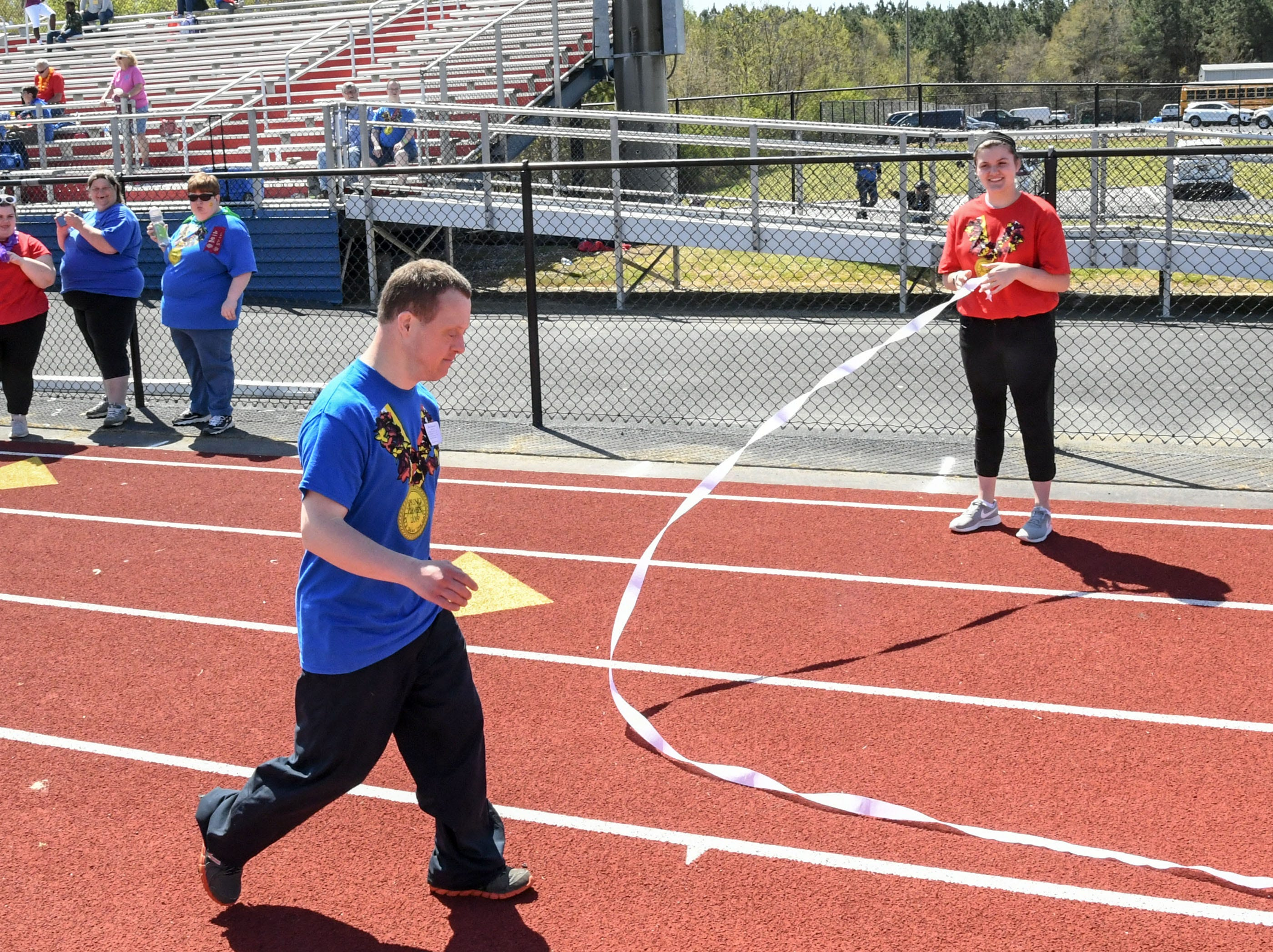 Brad Hammond of Anderson finishes the 100 yard walk during the Special Olympics South Carolina Area 14 Spring Games at Marlee Gambrell field at Belton-Honea Path High School Wednesday.