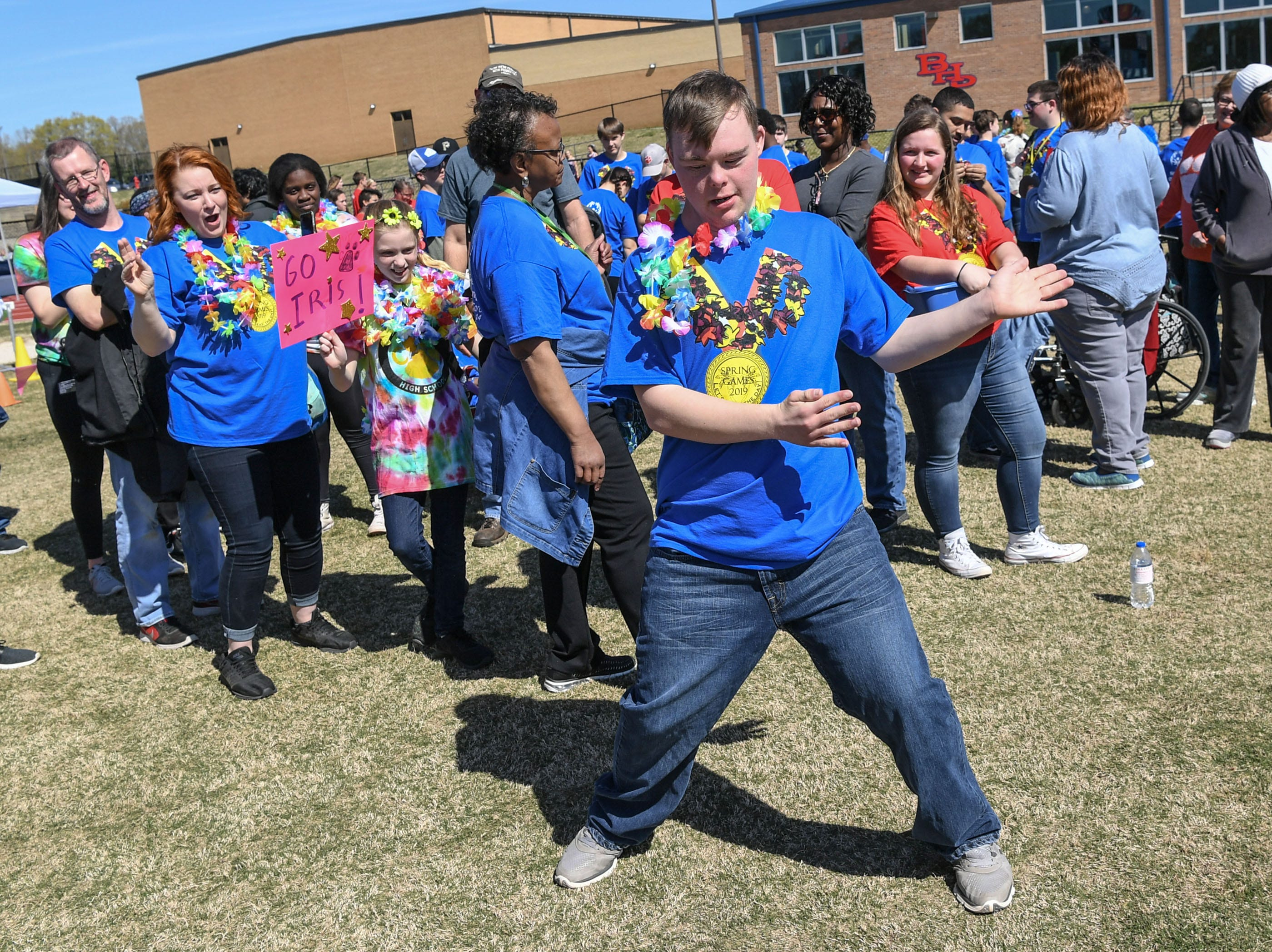 Harrison Harrell of Iva dances after he threw a softball far during the Special Olympics South Carolina Area 14 Spring Games at Marlee Gambrell field at Belton-Honea Path High School Wednesday.