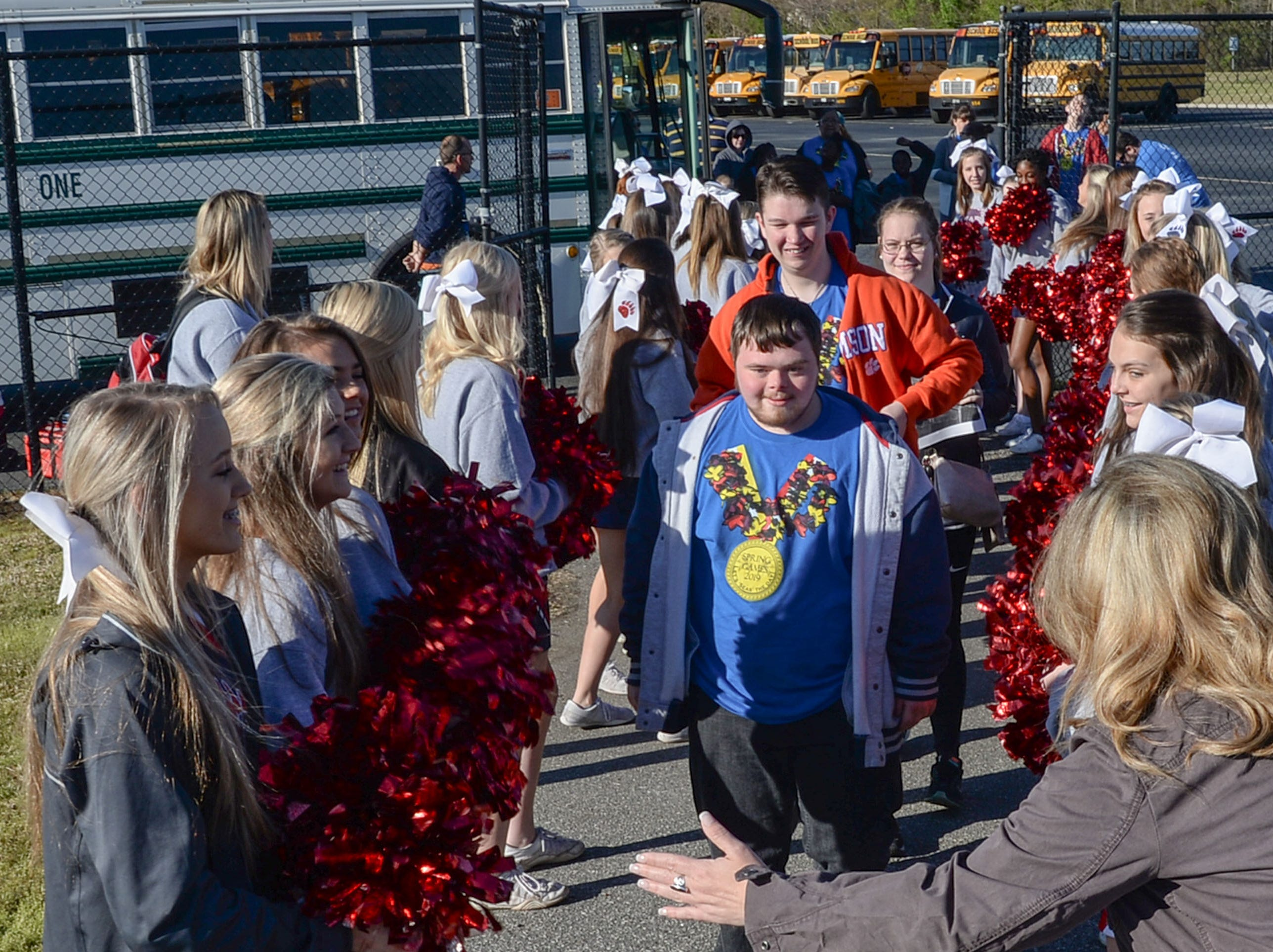 Cheerleaders from Belton-Honea Path High School greet athletes arriving before the Special Olympics South Carolina Area 14 Spring Games at Marlee Gambrell field at Belton-Honea Path High School Wednesday.