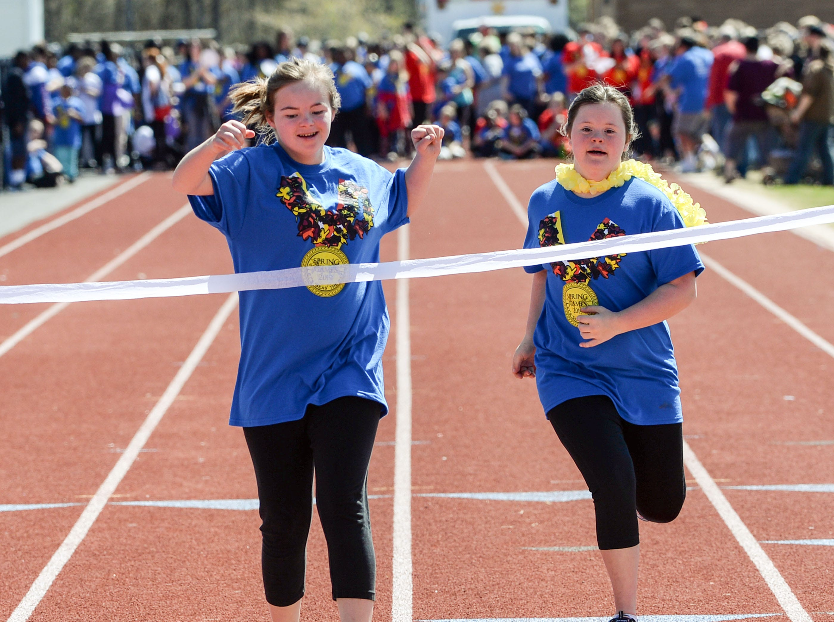 Emily Dove, left, of McCants Middle School in Anderson runs ahead of Gracie Peeples of Honea Path Middle School in the 100 yard dash during the Special Olympics South Carolina Area 14 Spring Games at Marlee Gambrell field at Belton-Honea Path High School Wednesday.