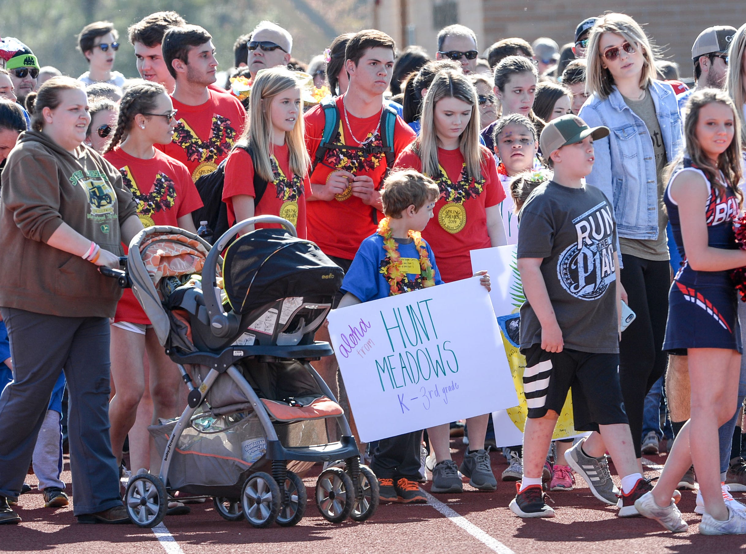 The opening parade with athletes from Hunt Meadows Elementary during the Special Olympics South Carolina Area 14 Spring Games at Marlee Gambrell field at Belton-Honea Path High School Wednesday.
