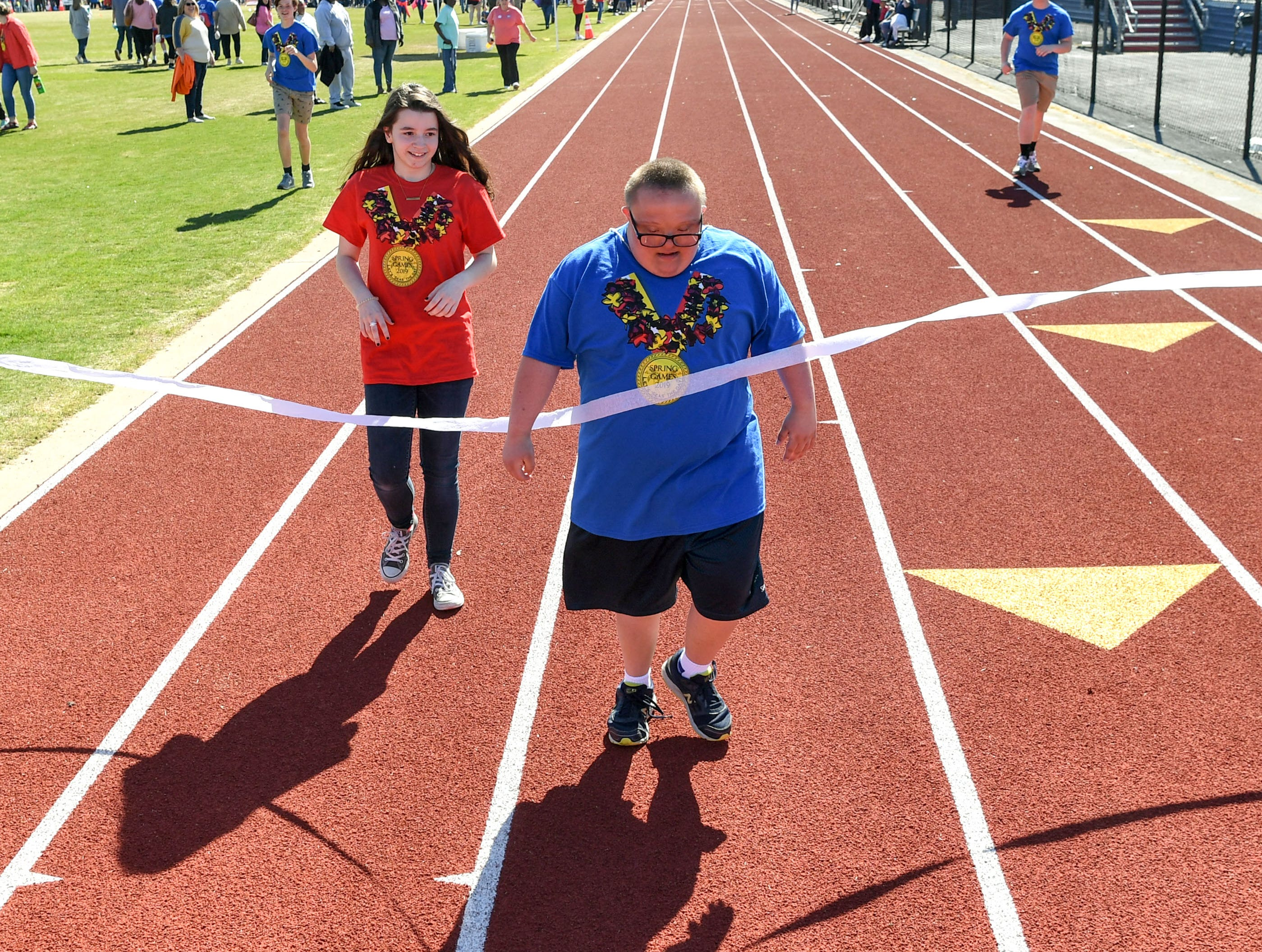 Cody Darby finishes the 100 yard walk during the Special Olympics South Carolina Area 14 Spring Games at Marlee Gambrell field at Belton-Honea Path High School Wednesday.