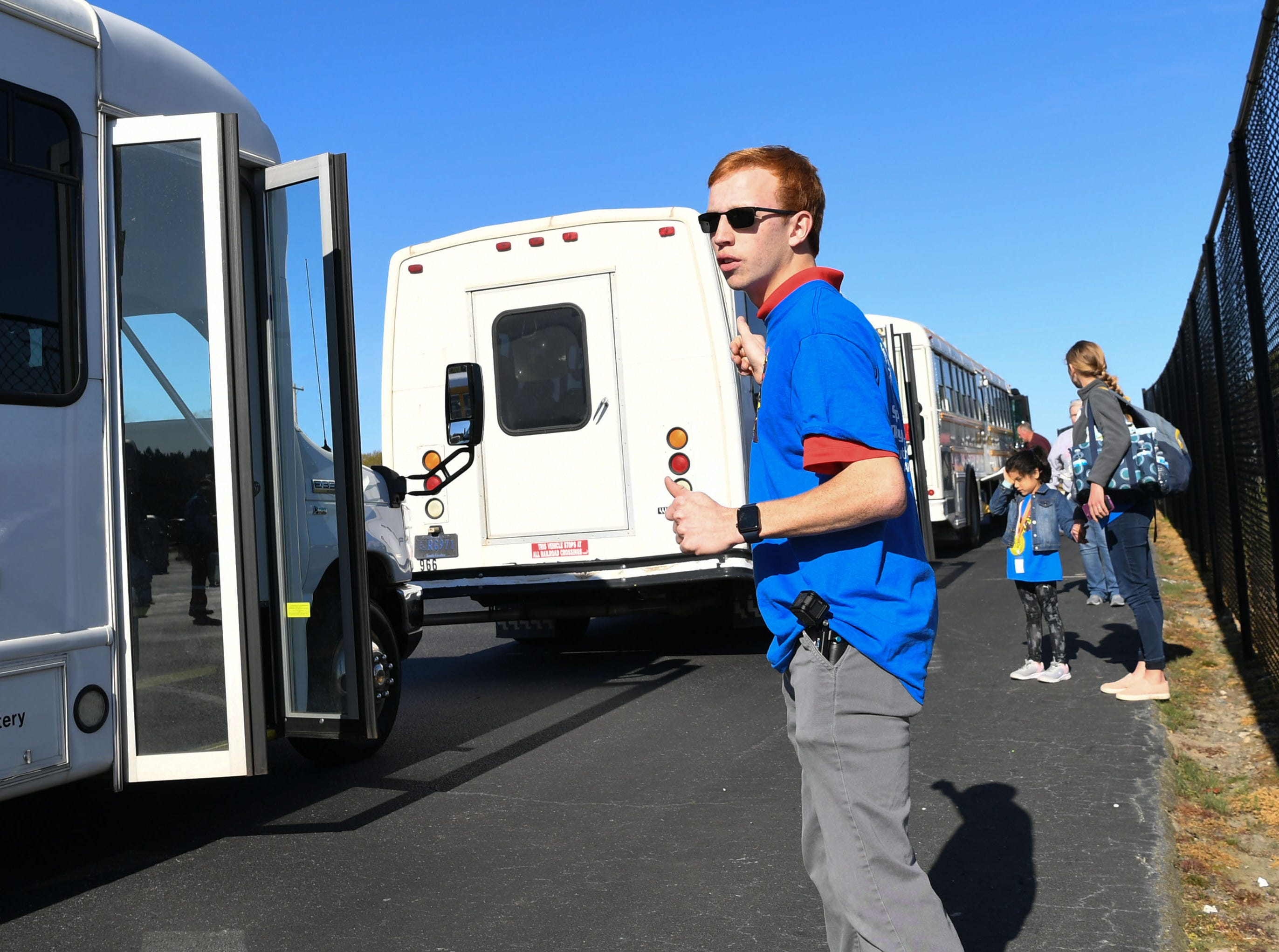 Sam Gilmer, a senior at Belton-Honea Path High School, helps direct athletes from the buses to the field during the Special Olympics South Carolina Area 14 Spring Games at Marlee Gambrell field at the school Wednesday.