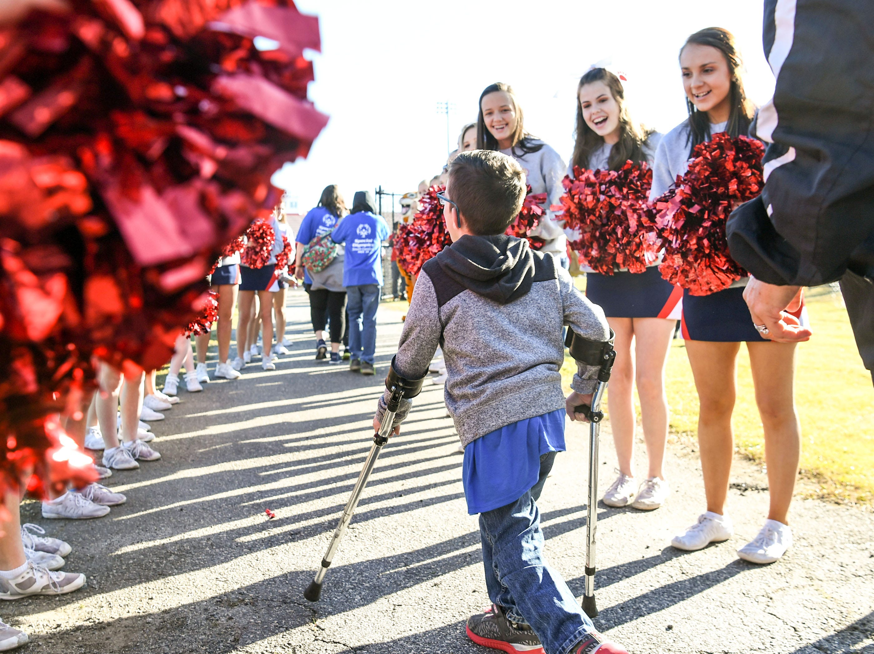 Belton-Honea Path cheerleaders greet athlete Landen Burdette, 9, of Iva Elementary arriving off the bus at the Special Olympics South Carolina Area 14 Spring Games at Marlee Gambrell field at Belton-Honea Path High School Wednesday.
