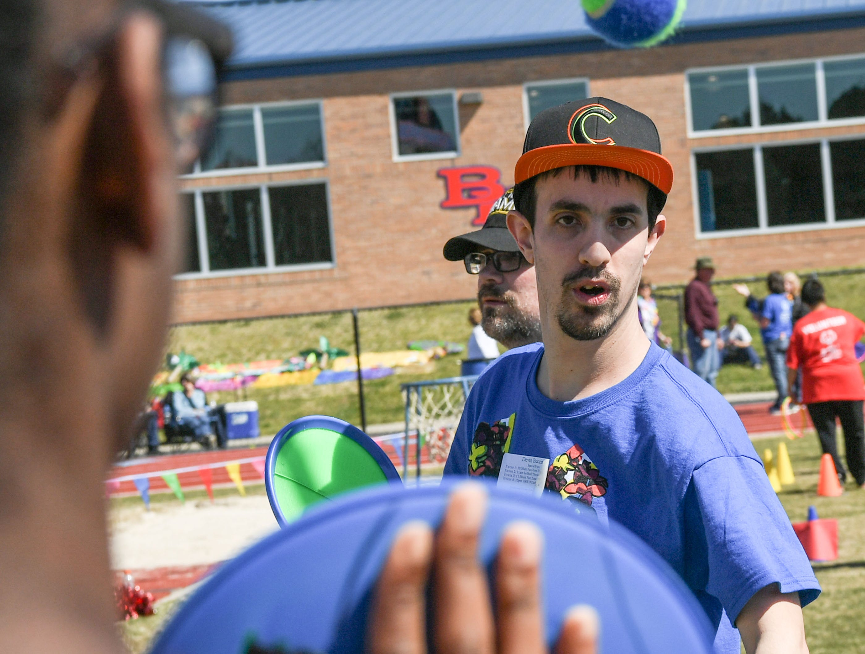 Devin Buccino throws a velcro ball in the fun zone during the Special Olympics South Carolina Area 14 Spring Games at Marlee Gambrell field at Belton-Honea Path High School Wednesday.