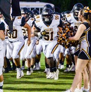Crescent defensive lineman and middle linebacker Ezekiel Jones (51) runs on the field before the game at Powdersville High School on Friday, September 28, 2018.