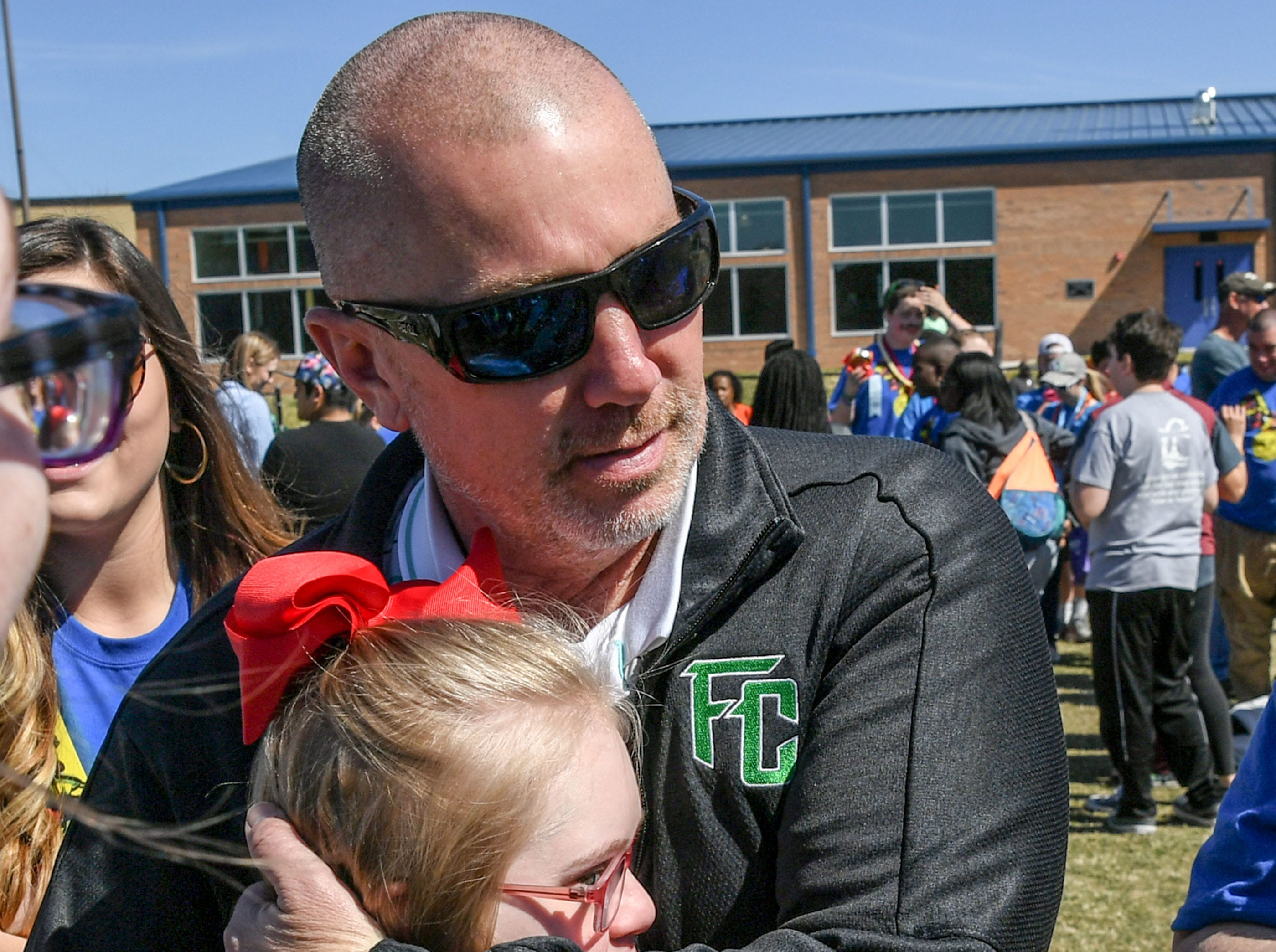 Ellie Dove, left, of Pendleton hugs her father Chris Dove during the Special Olympics South Carolina Area 14 Spring Games at Marlee Gambrell field at Belton-Honea Path High School Wednesday.