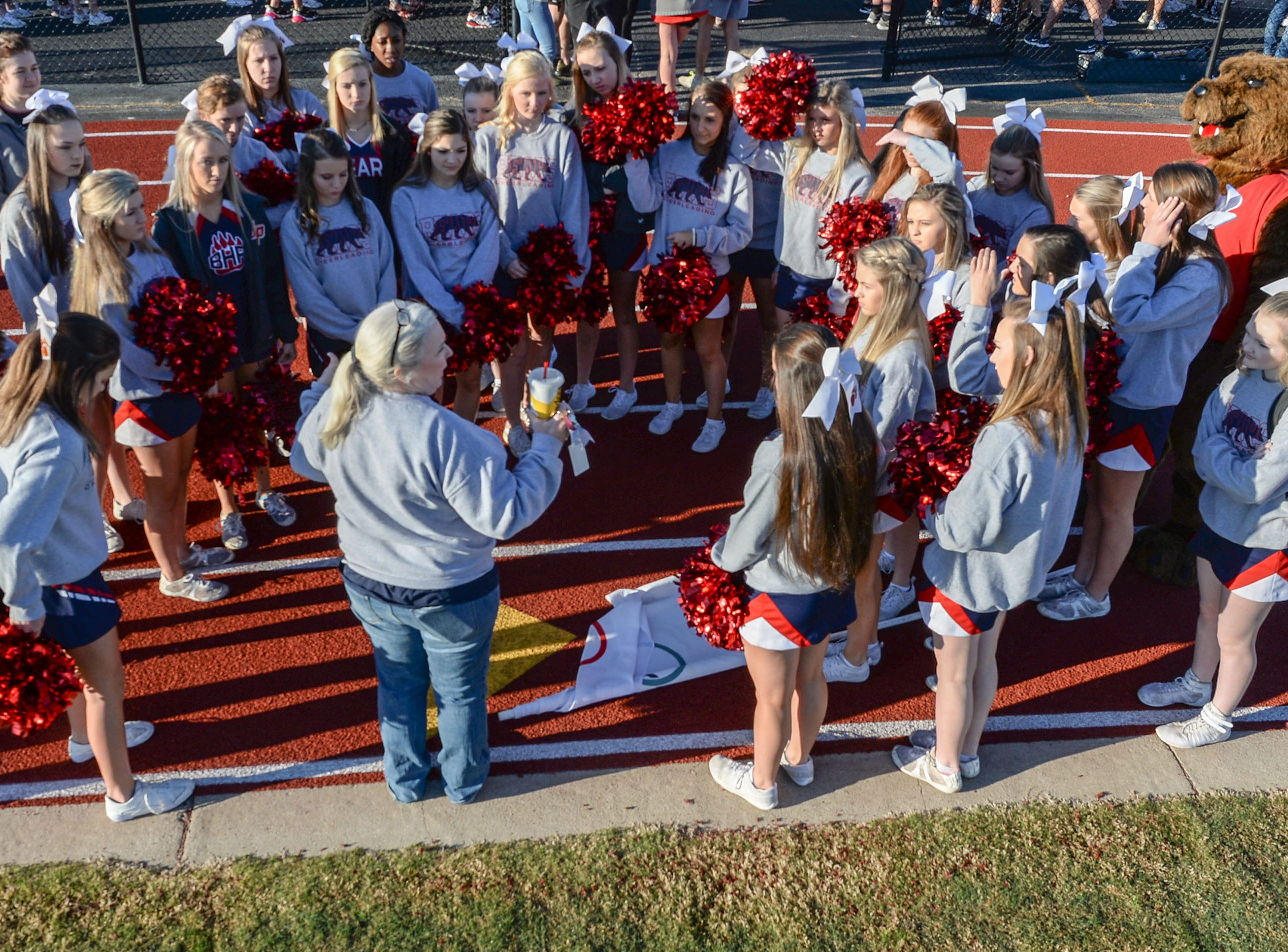 Cheerleaders from Belton-Honea Path High School gather before the Special Olympics South Carolina Area 14 Spring Games at Marlee Gambrell field at Belton-Honea Path High School Wednesday.