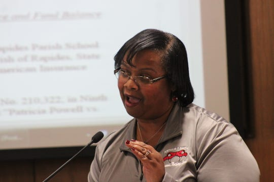 Arthur F. Smith Middle Magnet School Principal Carleesa White tells Rapides Parish School Board members Tuesday that, while she loves Peabody Magnet High School, she does not want her students transferred there and her school closed.