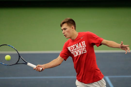 Neenah's Jared Lawatsch hits a volley during a first-round match at the WIAA state tournament last season at Nielsen Tennis Stadium in Madison.