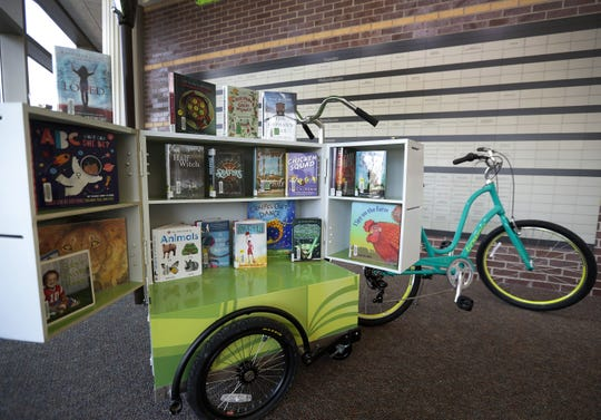 Neenah's Bibliocycle will be pedaled to parks and other locations in the city, allowing patrons to check out materials on the spot.