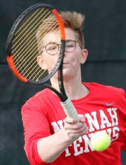 Neenah's Fritz Brownell competes in a doubles match against Appleton East during a Fox Valley Association tennis meet last season.