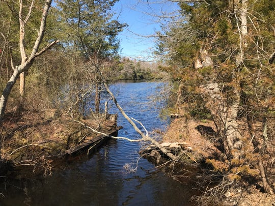 The Oswego River adjacent to the Cedar Bridge Taven County Historic Site deep in the Pine Barrens of western Barnegat.
