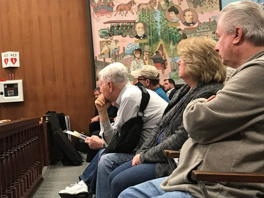 Opponents to a plan to put 556 duplexes at Lakewood's Eagle Ridge golf course fill a courtroom on April 2, 2019, when the planning board was slated to vote on the project.