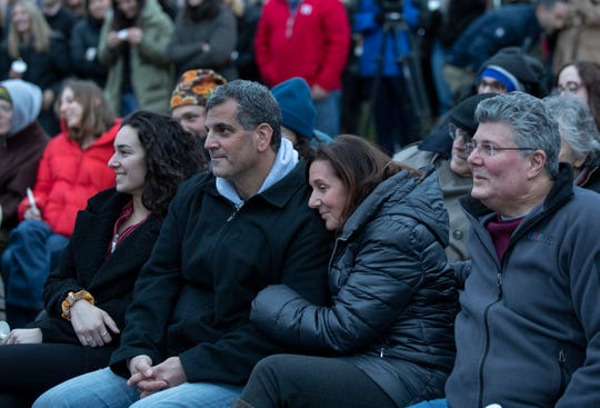 Seymour and Marci Josephson smile as Samantha friends talk about the good times. Hundreds attend memorial service at the West Town Center Lake gazebo in Robbinsville, N.J. for University of South Carolina senior Samantha Josephson. Josephson was killed after she mistakenly got into a car which she thought was the Uber ride she called.