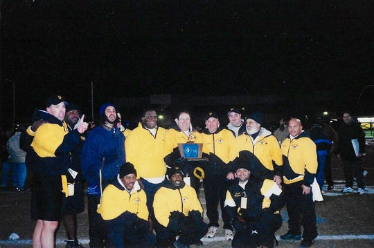Larry Lester (bottom row, far left) with Piscataway High School's footbal coaches after the unbeaten Chiefs won the sectional title in 2002.