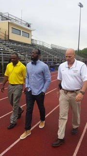 Left to right: Larry Lester Malcolm Jenkins and Dan Higgins in 2014.