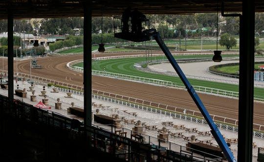 The Clockers' Corner area, the popular morning hangout for owners, trainers, jockeys and fans to watch workouts and grab breakfast, is empty at Santa Anita Park in Arcadia, Calif., Thursday, March 7, 2019. Extensive testing of the dirt track is under way at eerily quiet Santa Anita, where the deaths of 21 thoroughbreds in two months has forced the indefinite cancellation of horse racing and thrown the workaday world of trainers, jockeys and horses into disarray.