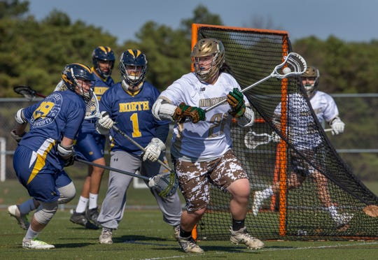 Brick Memorial's Rex Freeman looks for another option as his way to the goal is blocked during first half action. Toms River North Boys Lacrosse vs Brick Memorial in Brick N.J. on April 3, 2019.
