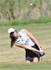 Wylie's Maddi Olson hits out of the bunker at 17. Olson won the District 4-5A girls golf title Tuesday, April 2, 2019, at Brownwood Club. She shot 77 on the final day to finish with a 148, six shots better than Aledo's Madison Head.