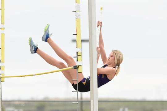 Wylie's Ambrey Pack clears the bar during the pole vault at the District 4-5A meet in Aledo on Wednesday, April 3, 2019. Pack tied for third at 7 feet, 6 inches to qualify for the area meet.