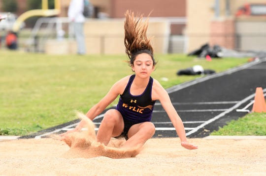 Wylie's Dusty Grant lands during the girls triple jump at the District 4-5A meet in Aledo on Wednesday, April 3, 2019. Grant won the district championship with a jump of 35 feet, 1-inch.