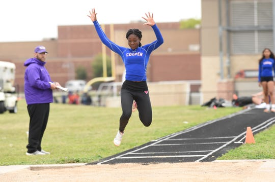 Cooper's Sidney Hayes goes into the air during the girls triple jump at the District 4-5A meet in Aledo on Wednesday, April 3, 2019. Hays finished fourth with a jump of 33 feet, 10 inches to qualify for the area meet.