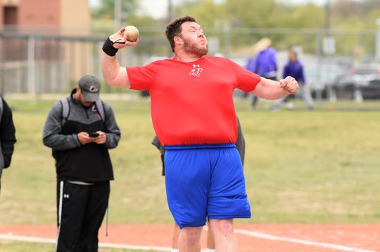 Cooper's McCord Whitaker throws the shot put at the District 4-5A meet in Aledo on Wednesday, April 3, 2019. Whitaker won the district championship with a throw of 51 feet, 5.5 inches.