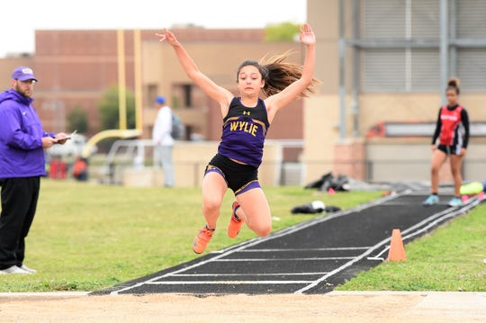 Wylie's Dusty Grant prepares to land during the girls triple jump at the District 4-5A meet in Aledo on Wednesday, April 3, 2019. Grant won the district title with a jump of 35 feet, 1-inch.