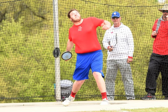 Cooper's McCord Whitaker prepares to throw the discus at the District 4-5A meet in Aledo on Wednesday, April 3, 2019. Whitaker won the district title with a throw of 172 feet, 3 inches.