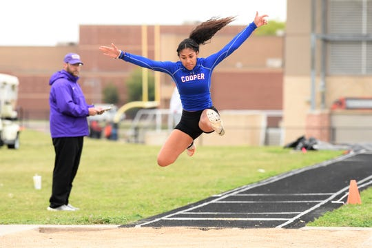 Cooper's Keiana Kemp prepares to land during the girls triple jump at the District 4-5A meet in Aledo on Wednesday, April 3, 2019. Kemp won bronze and advanced to the area meet with a jump of 34 feet, 4 inches.