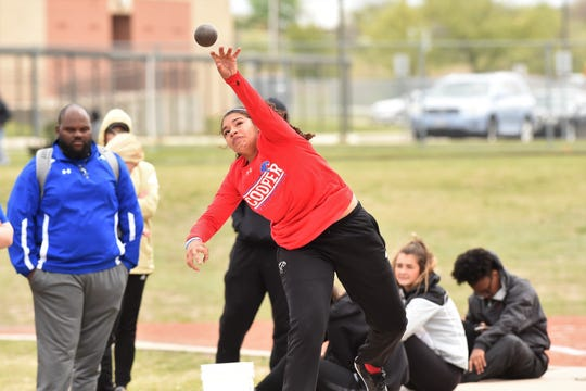 Cooper's Kaleigha Kemp lets go of the shot put at the District 4-5A meet in Aledo on Wednesday, April 3, 2019. Kemp placed fourth and qualified for the area meet with a throw of 33 feet, 7.25 inches.