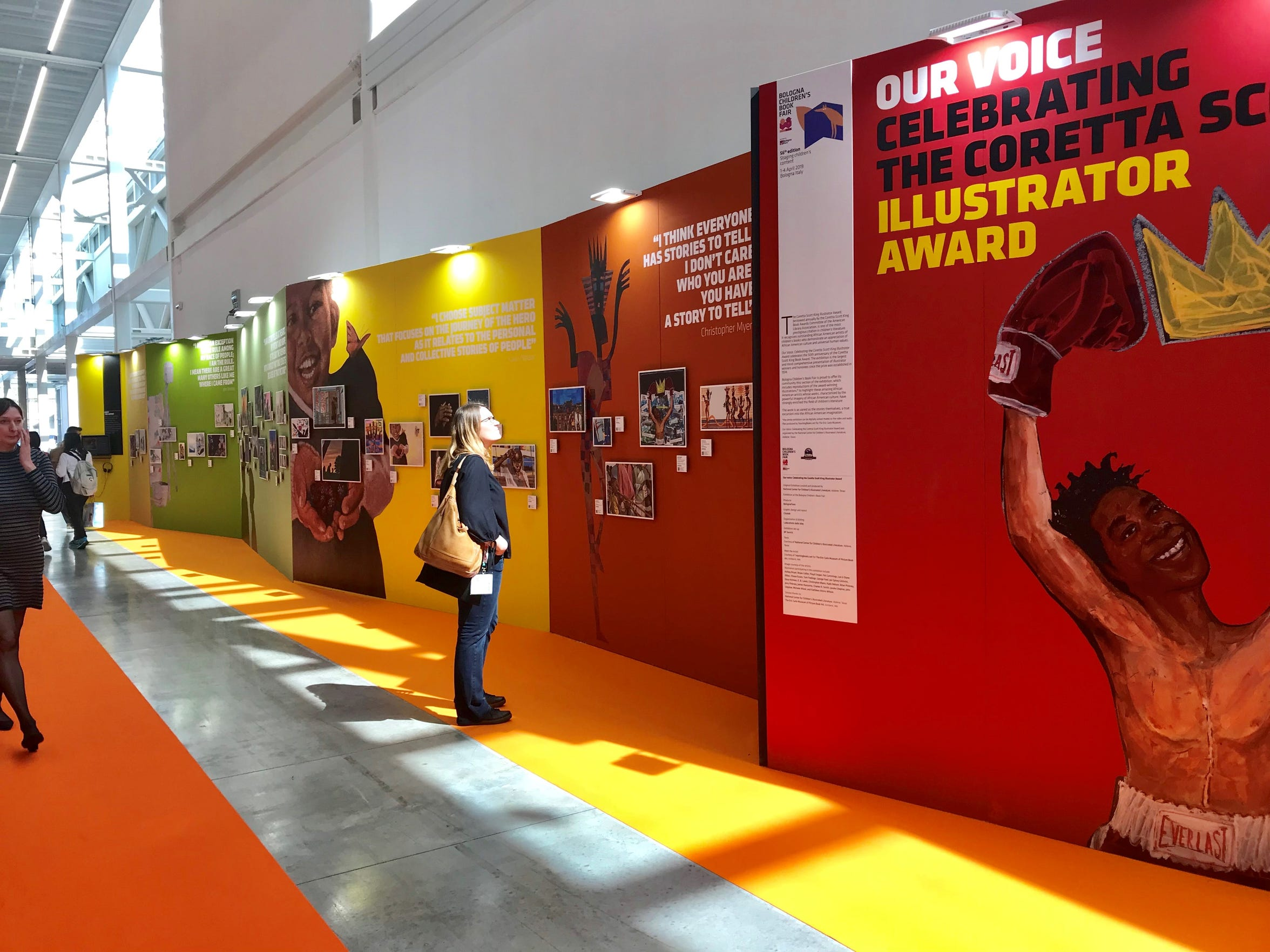 "The ""Our Voice: Celebrating the Coretta Scott King Illustrator Award"" exhibit currently on display in Bologna, Italy, at the city's annual Children's Book Fair."