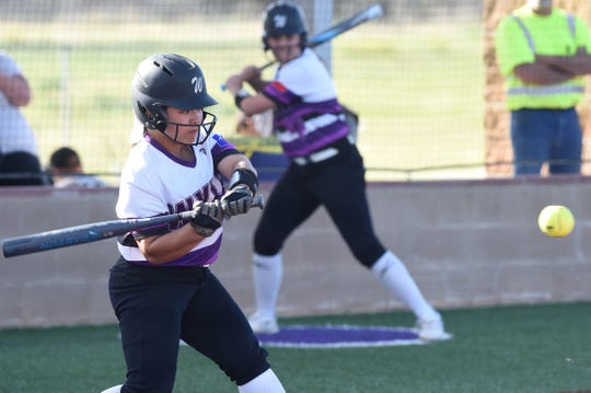 Wylie's Halle Arbilera (8) starts to swing at a pitch against Aledo on Tuesday, April 2, 2019. The Lady Bulldogs won 3-1 to remain tied for first place in District 4-5A.