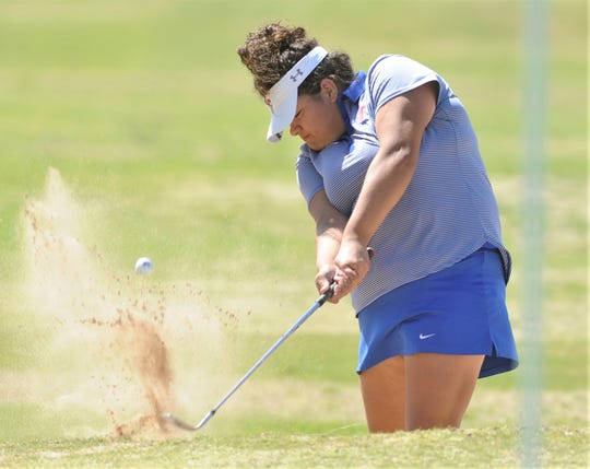 Cooper's Sarah Aitchison hits out of the bunker at 17. The junior shot 87 on Tuesday, April 2, 2019, to finish fifth at the District 4-5A tournament with a 171 at Brownwood Country Club. Aitchison and teammate Megan Cox nabbed the two at-large berths for the Region I-5A tournament later this month in Lubbock.