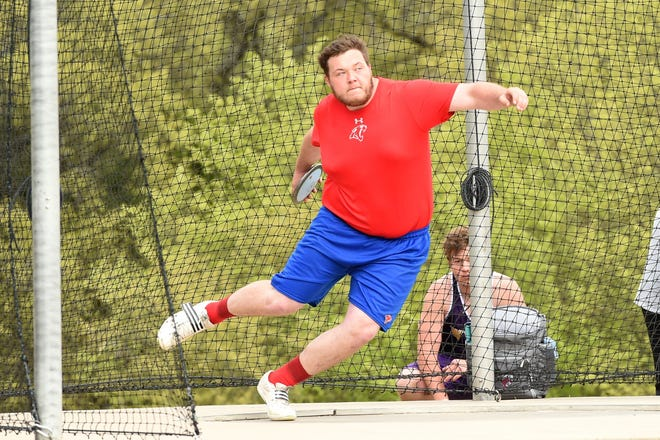Cooper's McCord Whitaker spins before throwing the discus at the District 4-5A meet in Aledo on Wednesday, April 3, 2019. Whitaker's throw of 172 feet, 3 inches won the district championship.