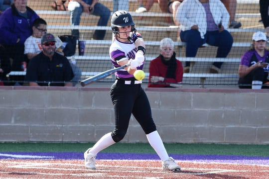 Wylie's Kylie Barnes (13) takes a swing against Aledo on Tuesday, April 2, 2019. The Lady Bulldogs won 3-1 to remain tied for first place in District 4-5A.