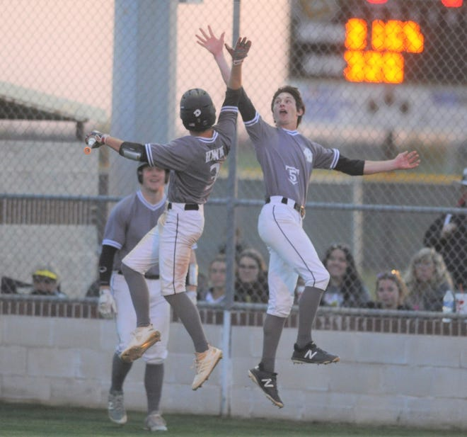 Clyde shortstop Ethan Hawk (3) and pitcher Payton Laughlin (5) high-five after Hawk scored in the fourth inning against Jim Ned in a District 5-3A baseball game Tuesday, April 2, 2019, at Bulldog Park.