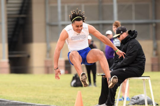 Cooper's Aeneas Favors competes in the boys long jump at the District 4-5A meet in Aledo on Wednesday, April 3, 2019. Favors won the district title with a jump of 22 feet.