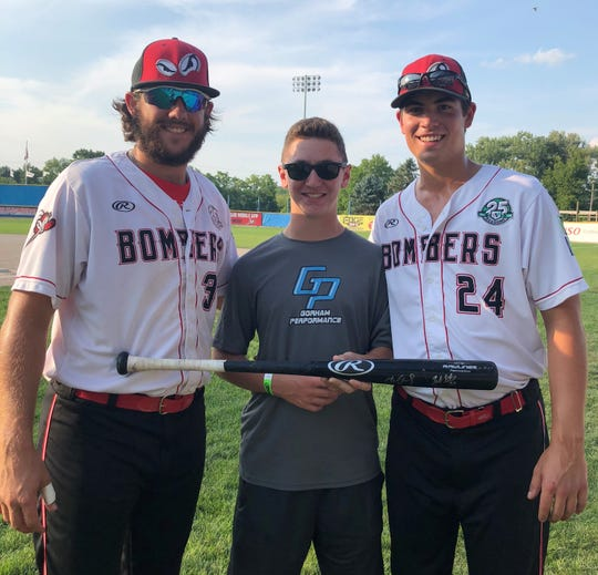 Former Battle Creek Bombers Zach Gartner and Michael McCraith pose with their Battle Creek 'brother' Nate Glubke. The two Bombers players spent the summer in Battle Creek as the Glubke's as their host family.