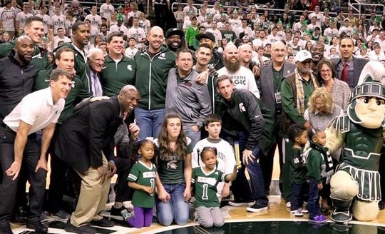 Members of the 2000 MSU National Championship team pose for a photo, including Steve Cherry, who was a walk-on from Coldwater.