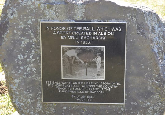 A plaque at Victory Park in Albion honoring Jerry Sacharski, credited with creating the sport and popularizing the game through a league in Albion.