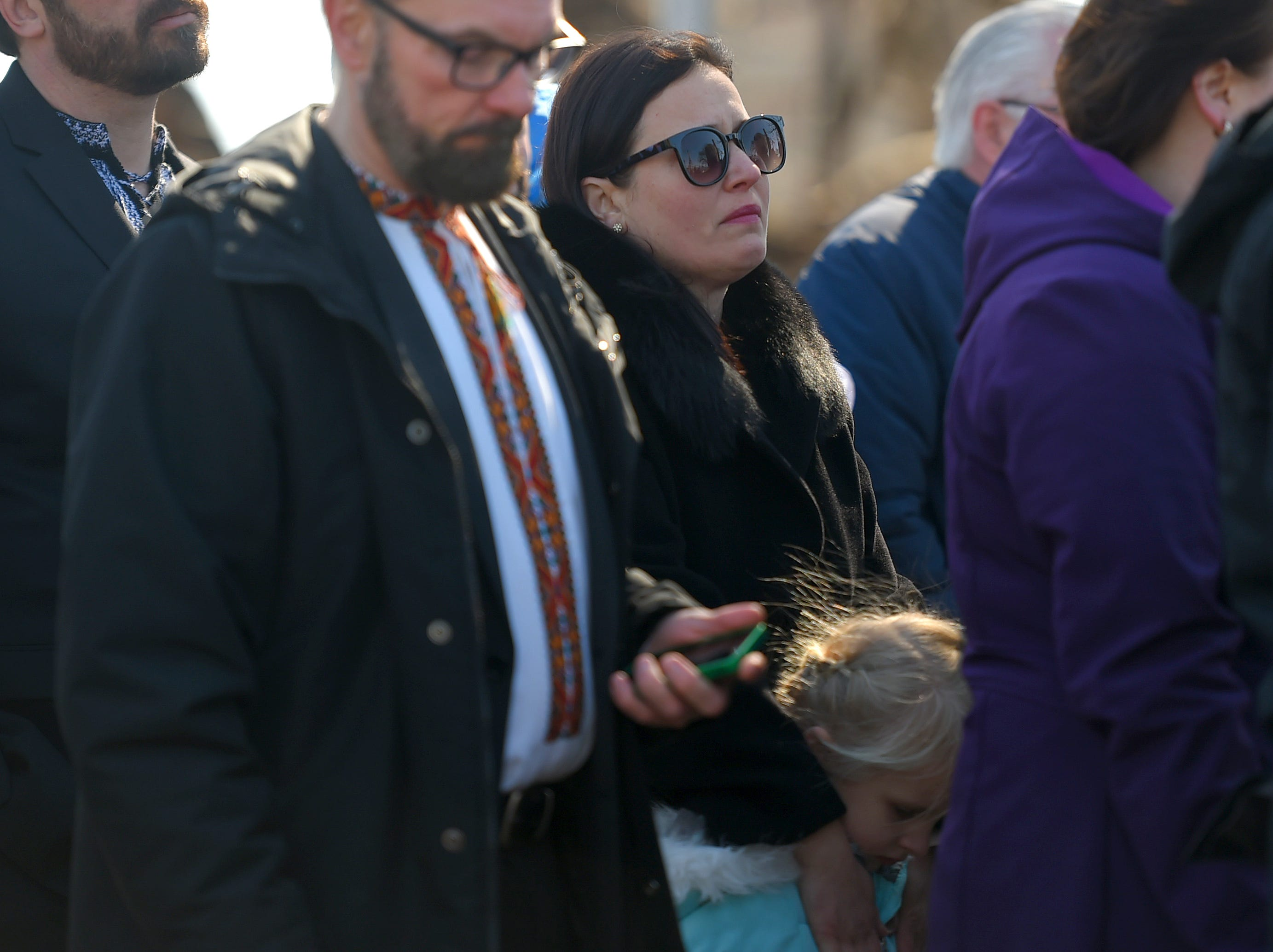 The family and friends of Maria Zobniw during the memorial service marking the tenth anniversary of the American Civic Association tragedy. Zobniw was among the 13 people killed during the mass shooting. April 3, 2019.