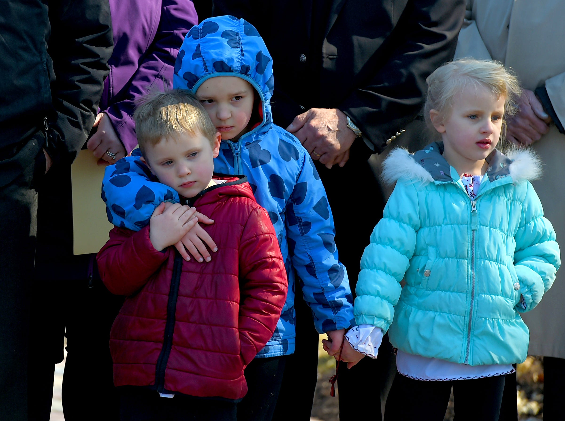 The grandchildren of Maria Zobniw, who was among the 13 victims of the 2009 mass shooting at the American Civic Association in Binghamton, during a Wednesday gathering at the ACA Memorial which was held in honor the tenth anniversary of the tragedy. April 3, 2019.