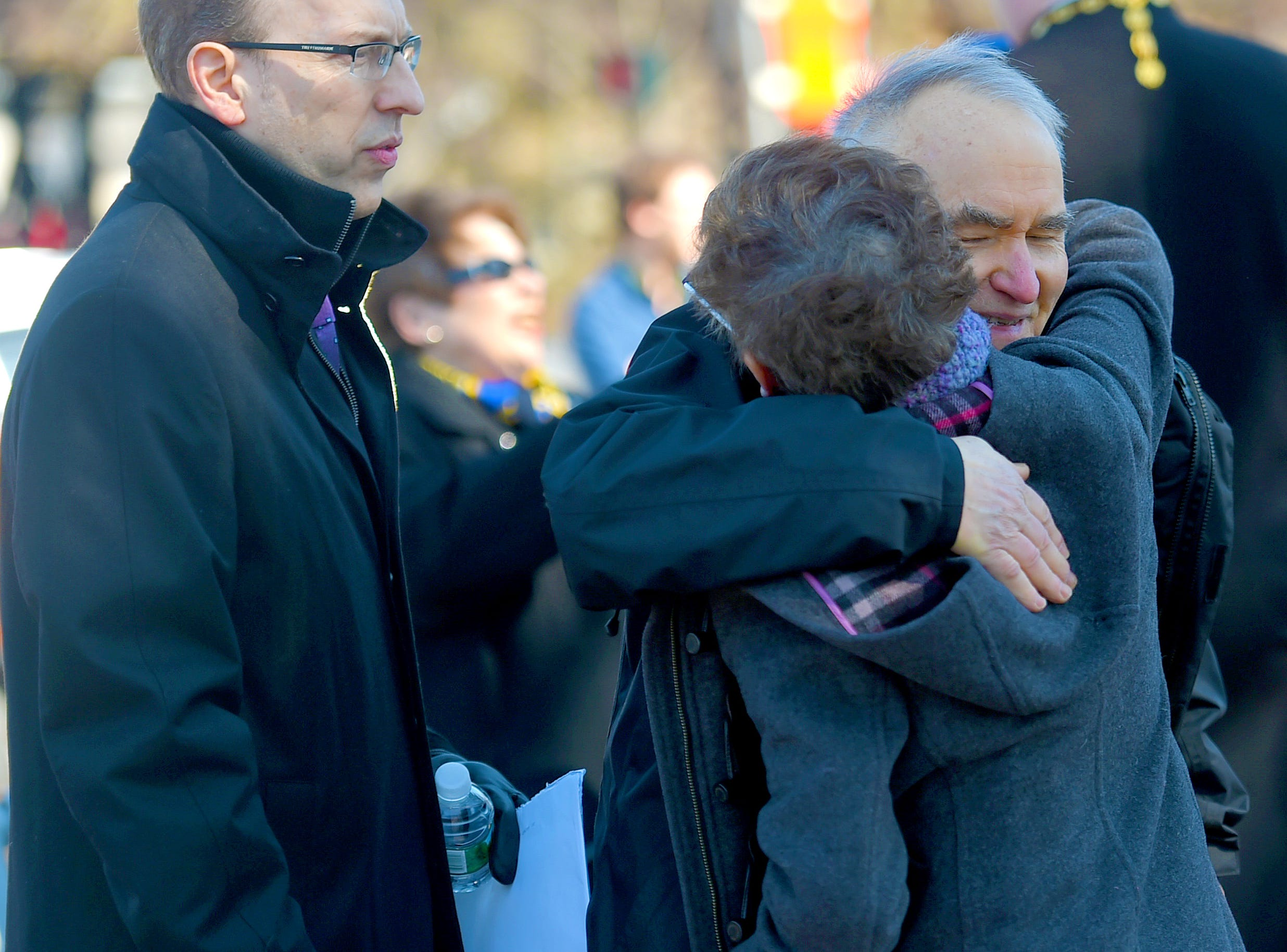 The families of victims Roberta King and Maria Zobniw greet each other before the morning gathering to honor  the 13 victims of the 2009 mass shooting at the American Civic Association in Binghamton.  April 3, 2019.